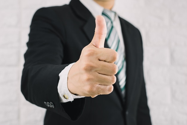 Business man thumbs up like is excellent