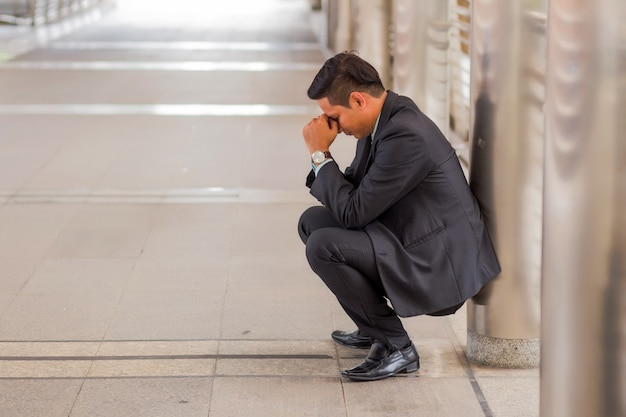 Business man tired or stressed after his work. image of stressed businessman concept.