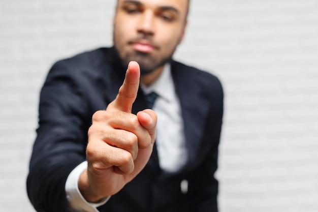 Business man touching an imaginary screen