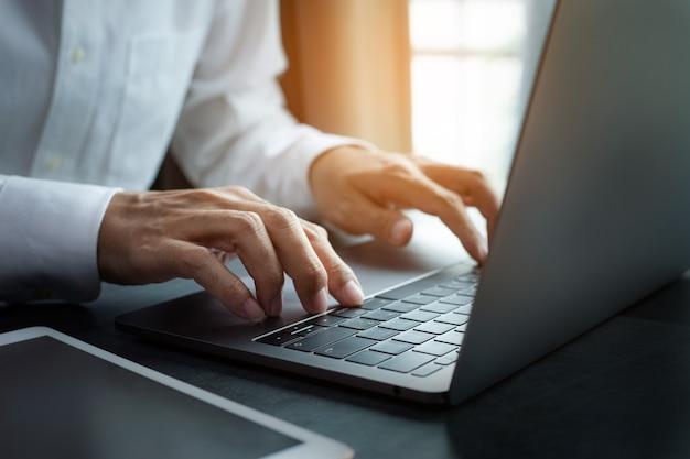 Business man typing keyboard on laptop or computer
