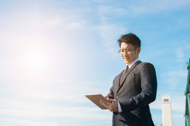 Business man use tablet for connection and internet about business, technology concept