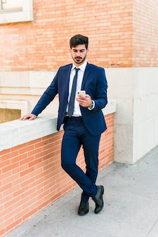 Business man using his smartphone