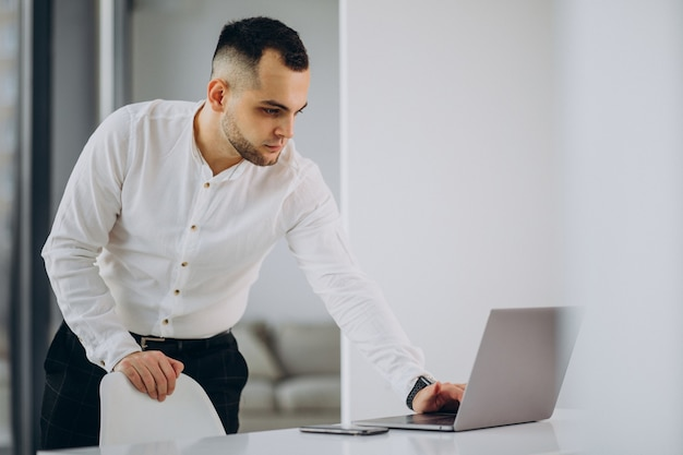 Business man using laptop in office