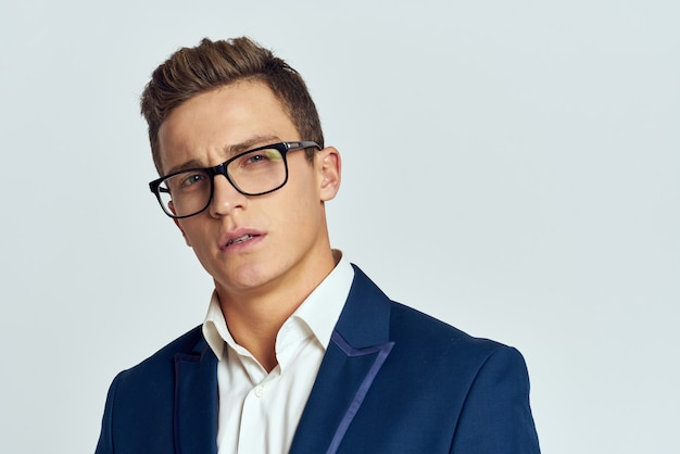 Business man wearing glasses and blue suit
