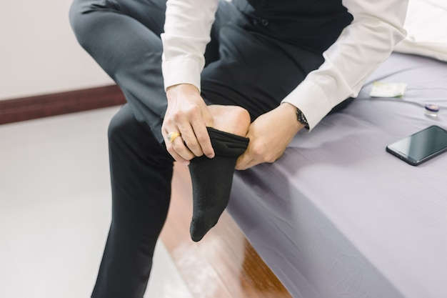 Business man wears shoes. to prepare for work or  the meeting
