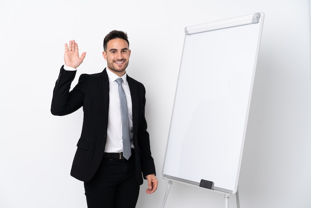 Business man with beard with white board over isolated wall