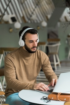 Business man with headphones working