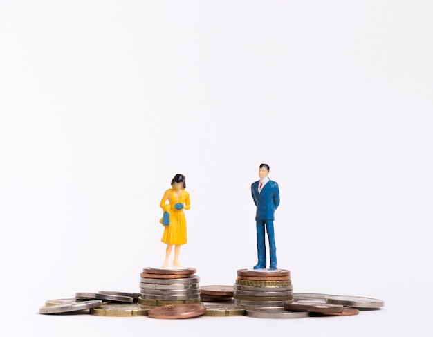 Business man and woman sitting on coins