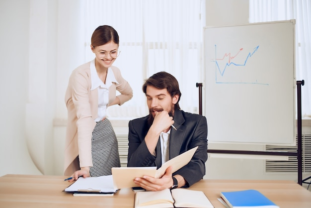 Business man and woman sitting at work desk office team communication