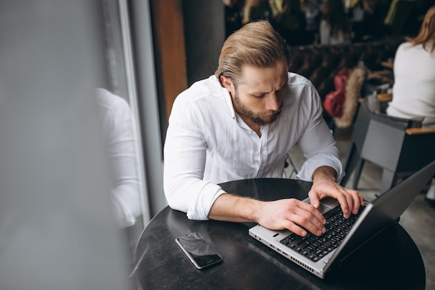 Business man working on computer in a cafe