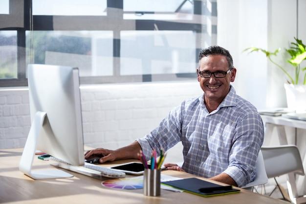 A business man working at computer desk