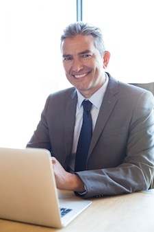 Business man working on laptop in a conference room during meeting at office