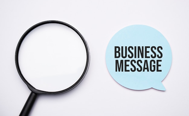 Business meeting speech bubble and black magnifier isolated on the yellow background.