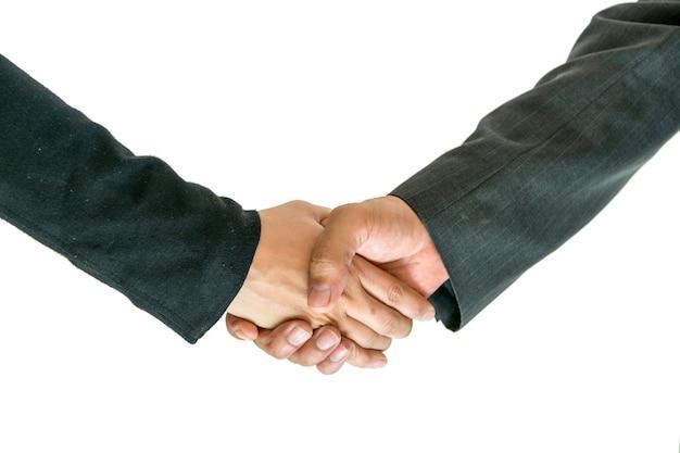 비즈니스 남성과 여성이 서로 악수하여 함께 작동합니다.