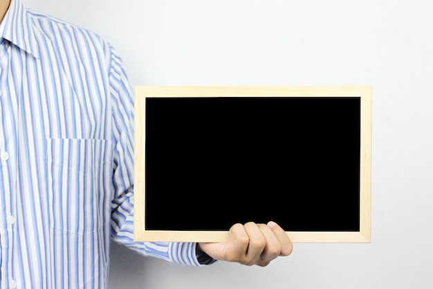 Business men are holding a blank photo frame.