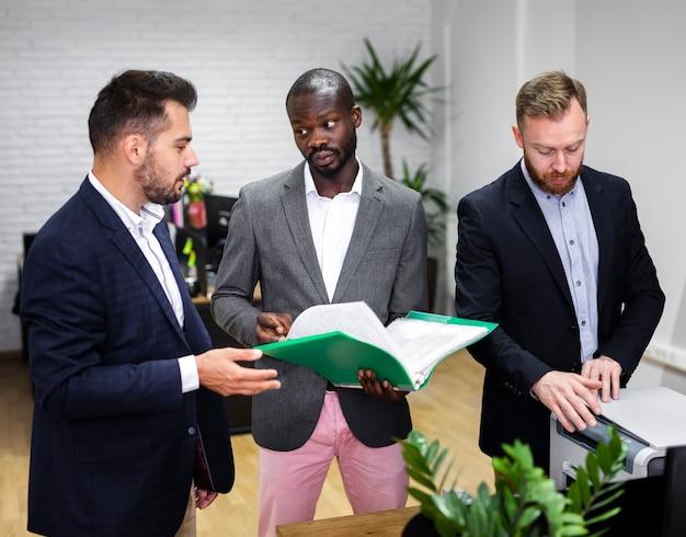 Business men checking folders