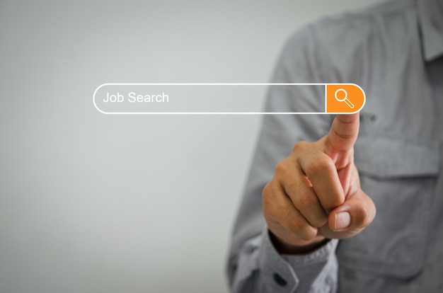 Business men clicking on the internet to search for jobs on computer touch screen