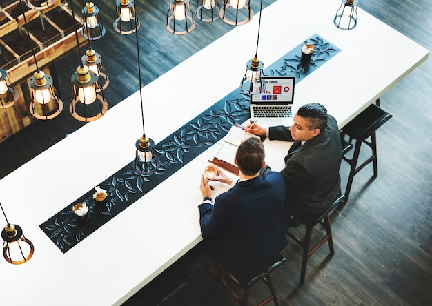 Business men having a meeting in a cafe
