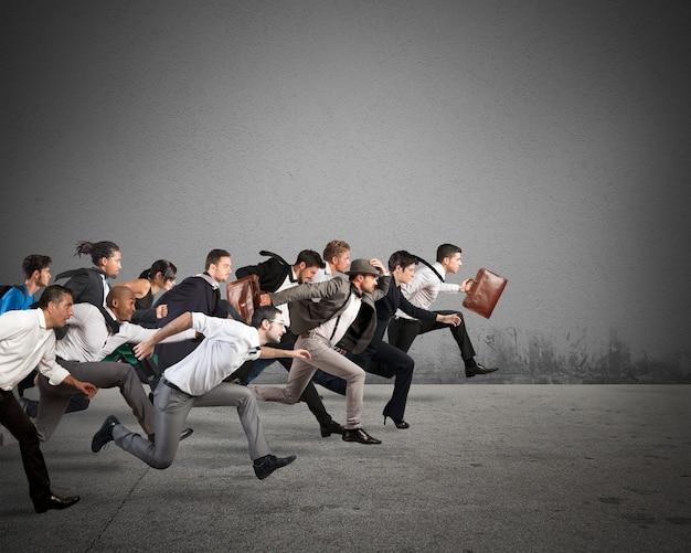 Business men run to reach the goal