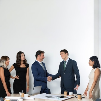 Business men shaking hands front view