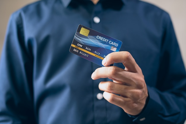 Business men use credit cards in blue