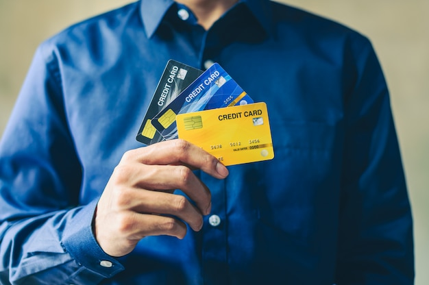 Business men use credit cards in shopping and doing business