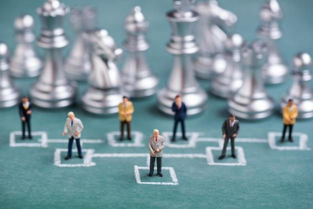 Business miniature people in chalk organization chart