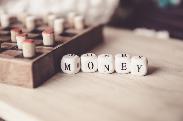 Business money word collected of elements of wooden elements with the letters money and bo