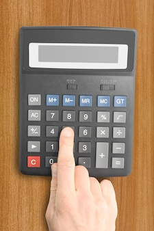 Business objects. electronic calculator with a hand