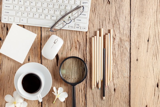 Business objects on old wooden table background