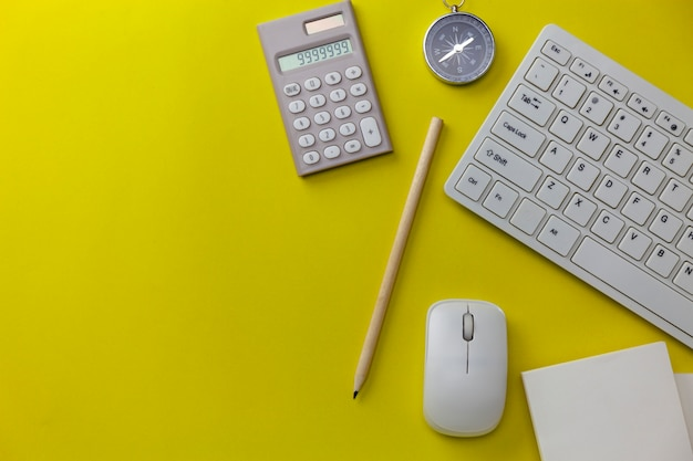 Business objects on yellow background, business direction concept
