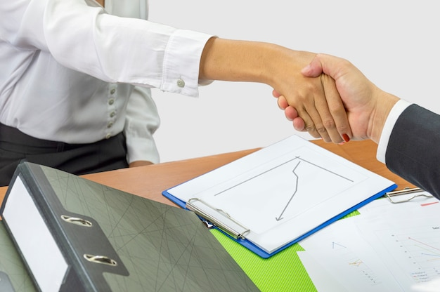 Business and office concept - shaking hands with partners