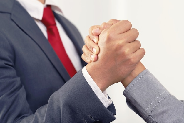 Business and office concept - two business people shaking hands