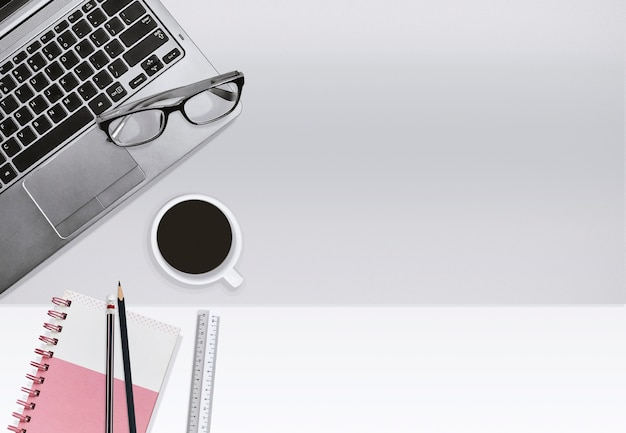 Business office workplace, education concept. laptop and notebook with coffee cup