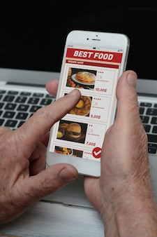 Business old man with phone ordering take away food