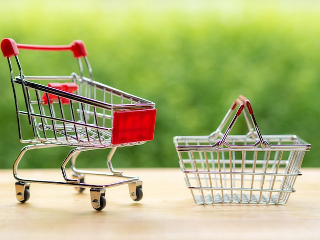 Business online seller, small cart and basket on the wood table