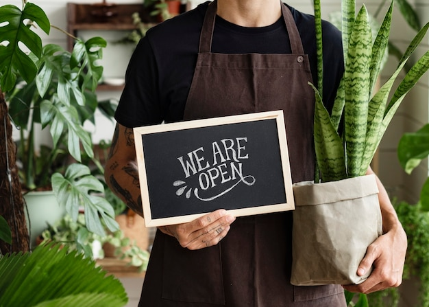 Business owner holding we are open sign