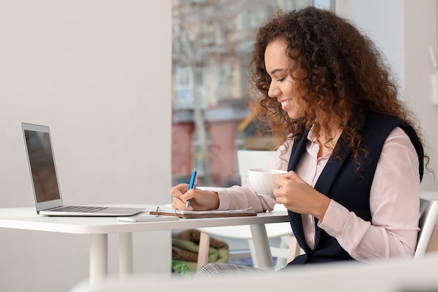 Business owner working in her cafe