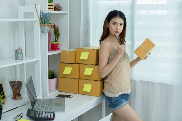 Business owner working at home office packaging