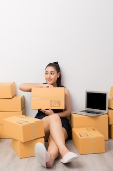 Business owner working with boxes