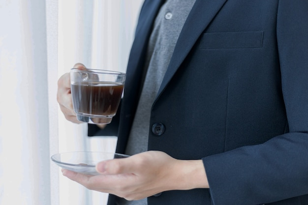 Business partners concept a young male entrepreneur enjoying with tasty coffee while creating concept of a new project.