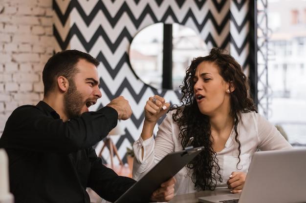 Business partners giving fist bump, successful teamwork