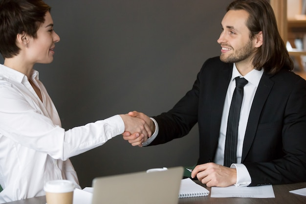Business partners handshaking after closing successful deal