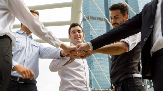 Business partners put fists in circle fist bump. team building, support and synergy