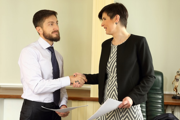 The business partners signed an agreement in the office
