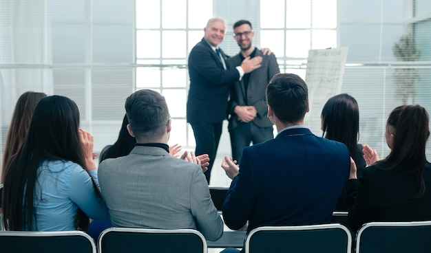 Business partners standing together in a conference room during a business meeting.