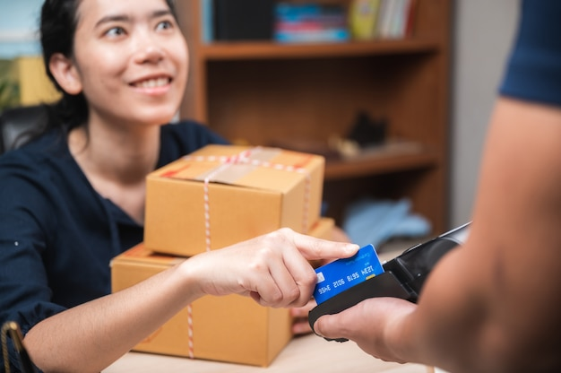 Business paying with credit card machine, client purchase payment concept