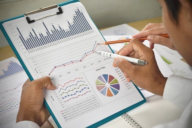 Business people analysis financial graphs and charts on desk.