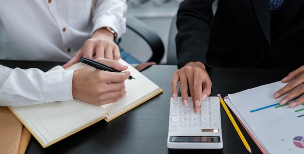 Business people analyzing statistics business documents, financial concept