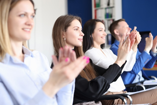Business people applaud at training conference closeup
